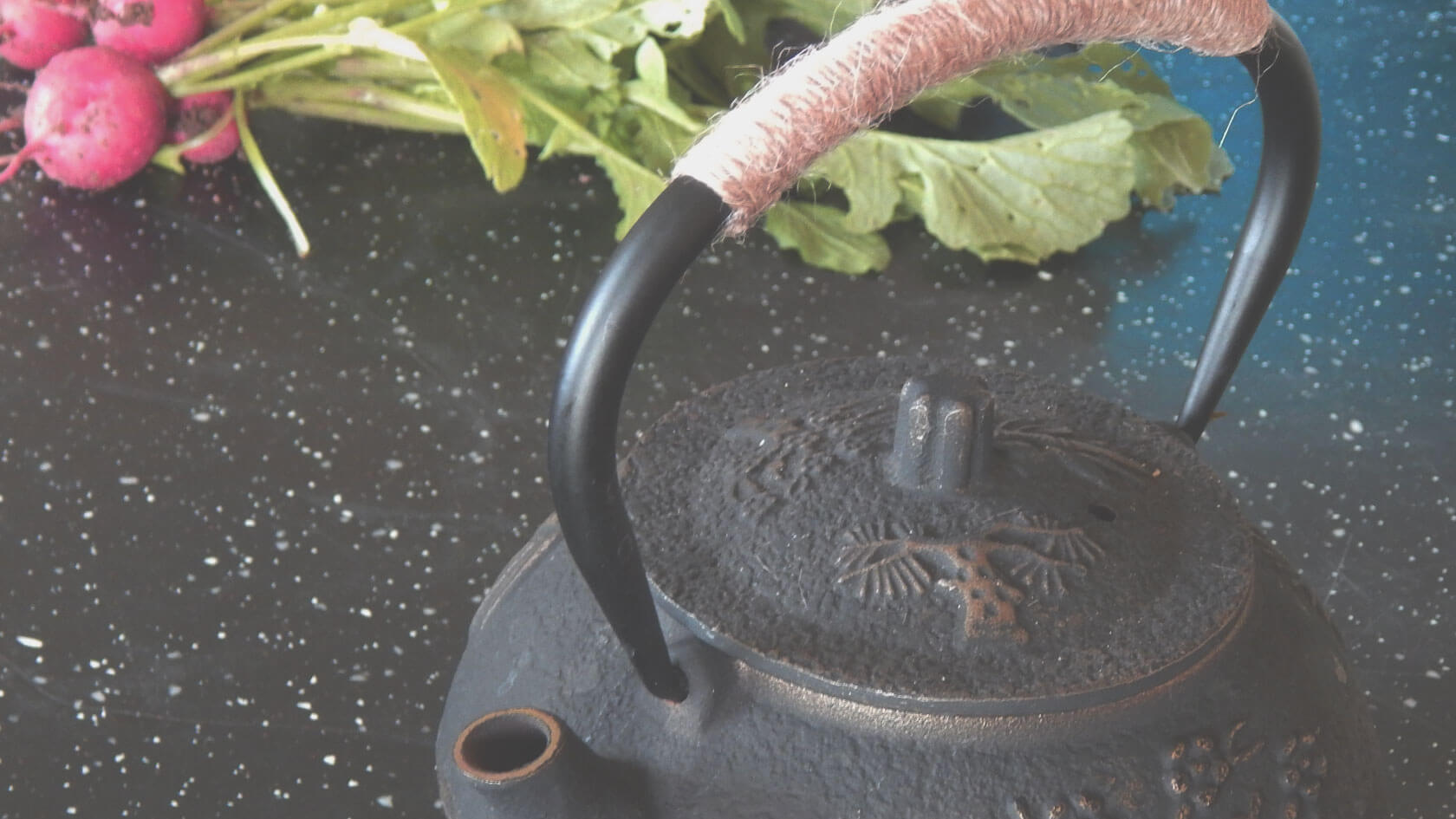 Traditional Japanese teapot and radishes