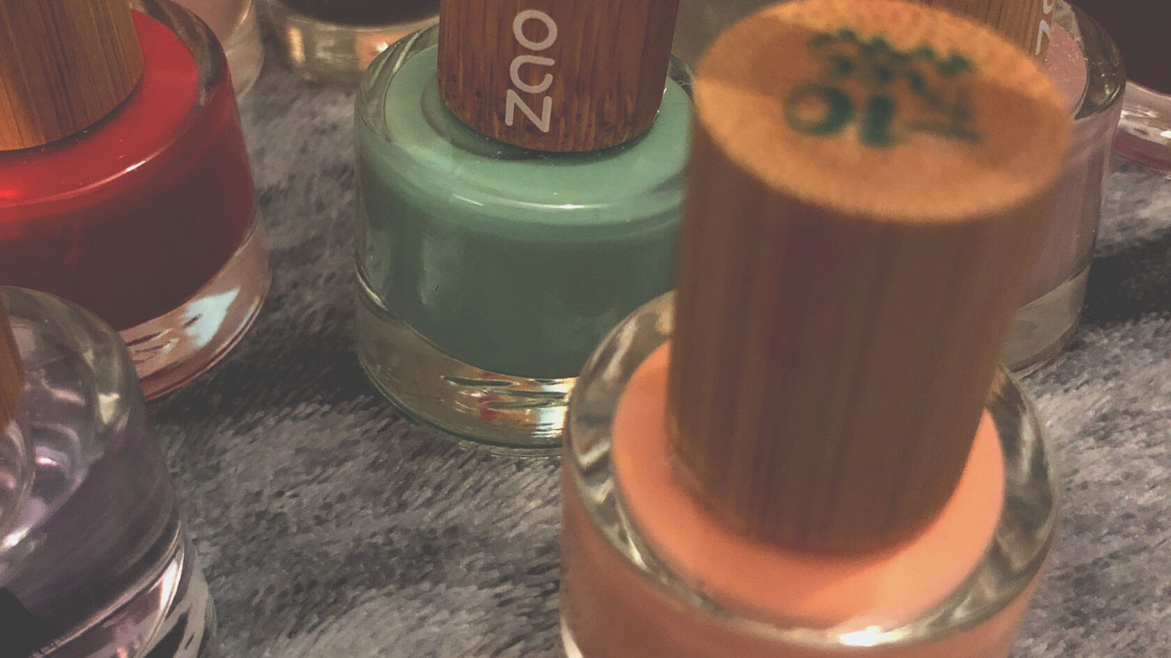 Close-up of ZAO nail polishes of different colours, and clear undercoat